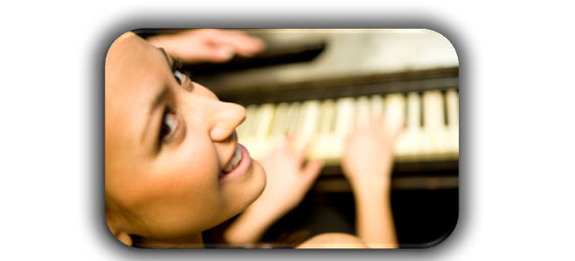 girl smiling playing on piano